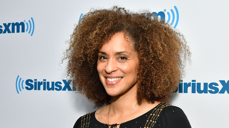 Karyn Parsons smiling at event