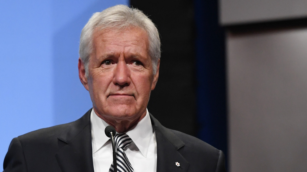 Alex Trebek in striped tie looking serious