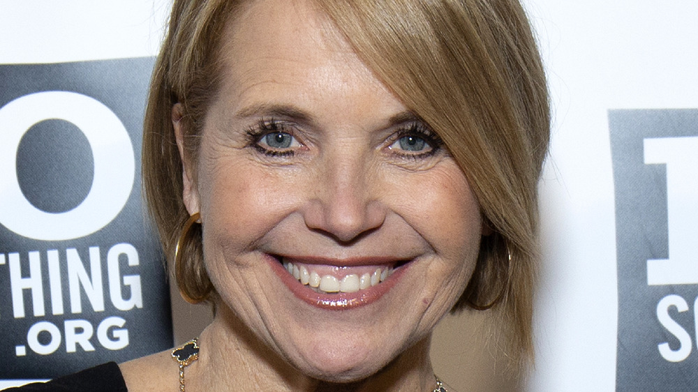 Katie Couric smiling on the red carpet