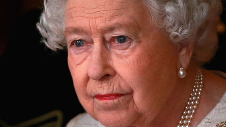 Queen Elizabeth looks away from the camera