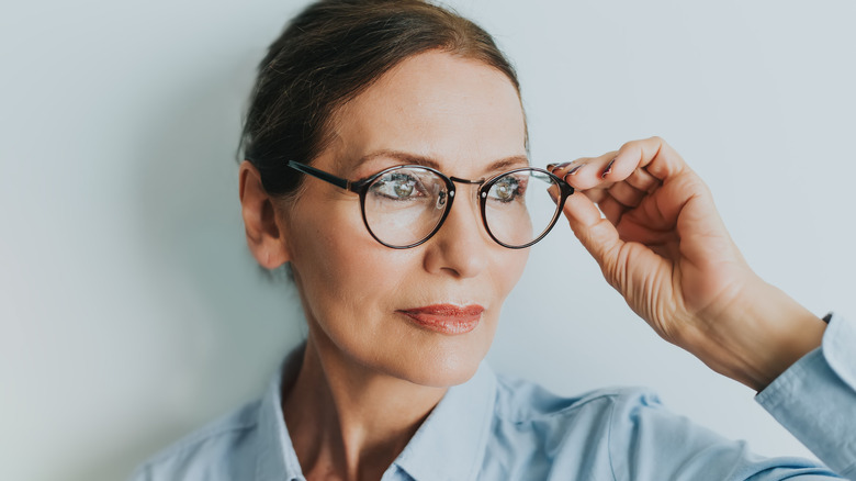 Woman with glasses and her hair pulled back