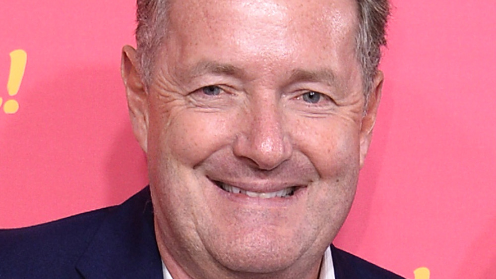 Piers Morgan pink background