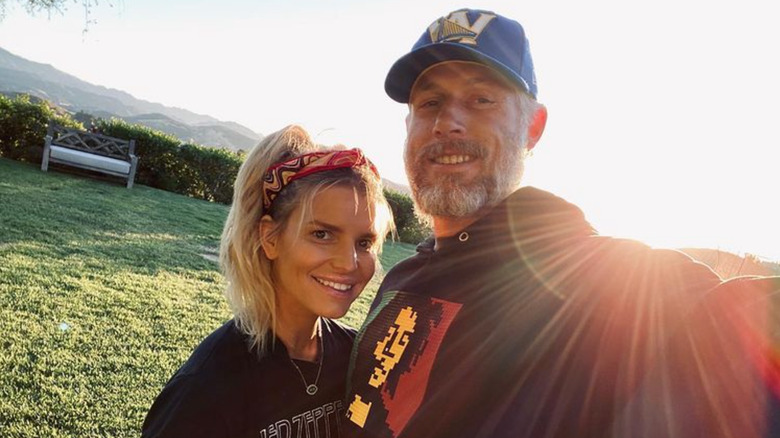 Jessica Simpson and her husband outside