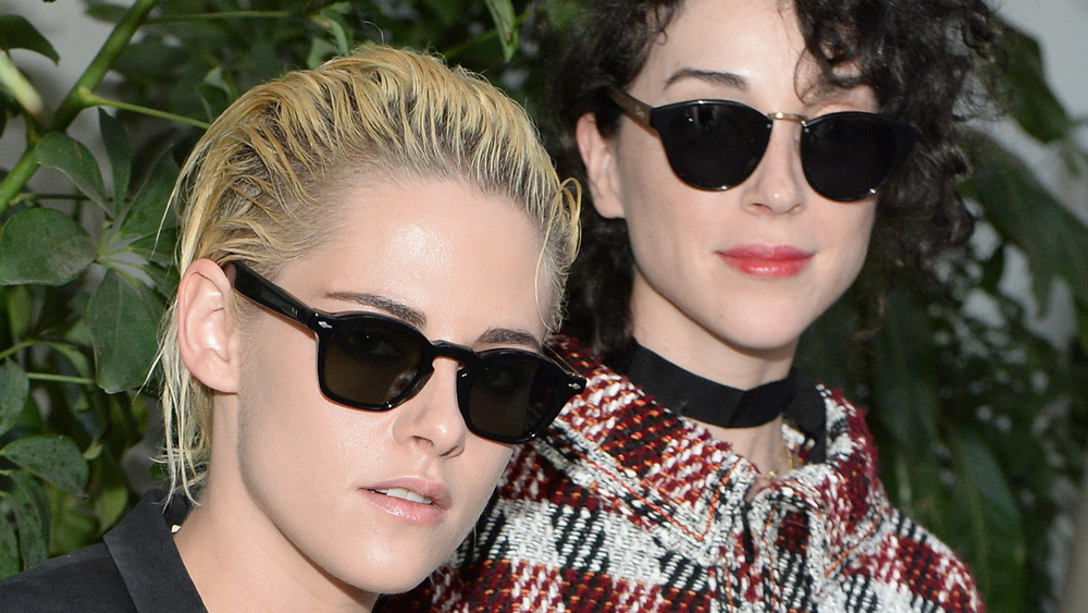 Kristen Stewart and St. Vincent wearing sunglasses at a fashion show