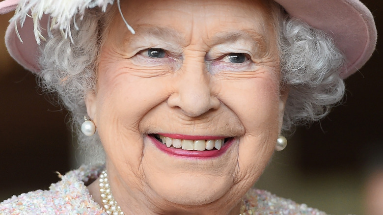 Queen Elizabeth smiling in pink