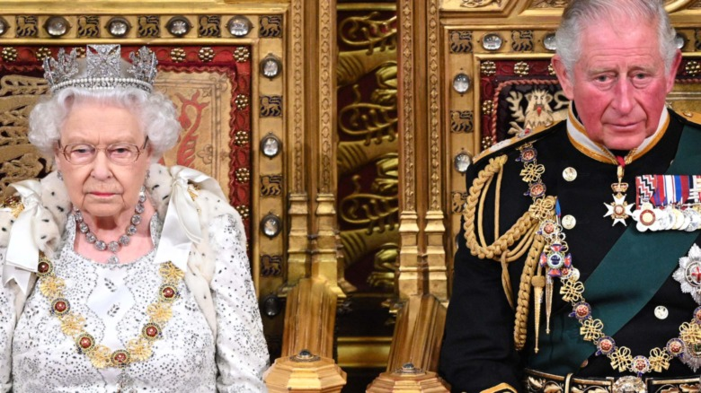 Prince Charles and Queen Elizabeth sitting on throne