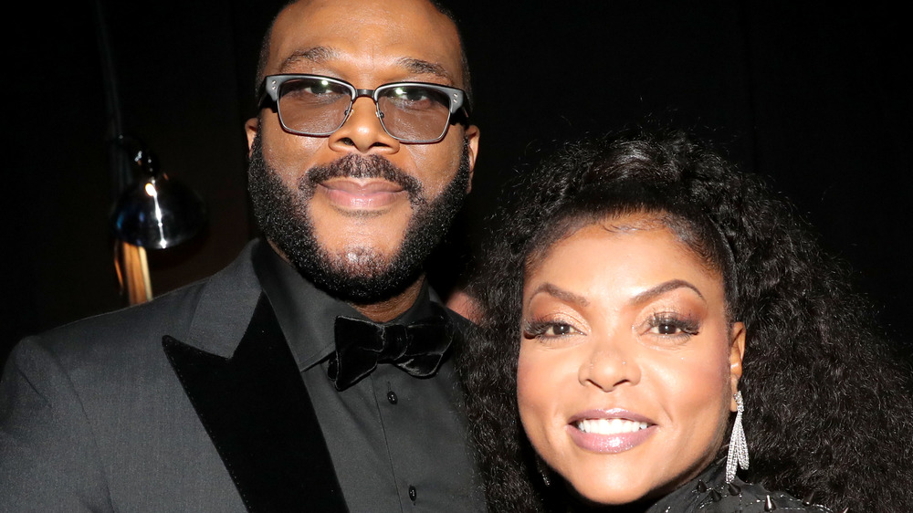 Taraji P. Henson and Tyler Perry wear black and smile.