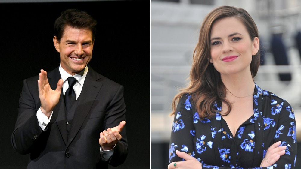 Tom Cruise waving and Hayley Atwell smiling