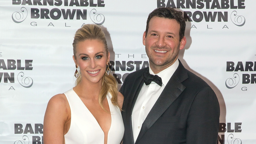 Tony Romo and his wife Candice Crawford pose together