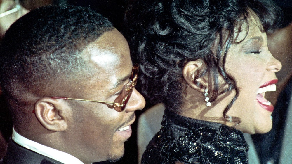 side profile of singers Whitney Houston and Bobby Brown