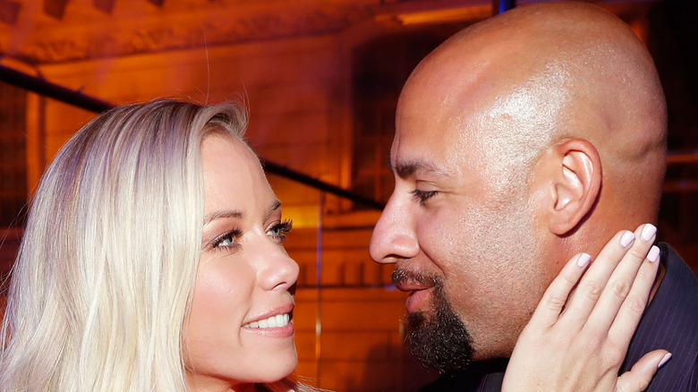Kendra Wilkinson and Hank Baskett looking at each other
