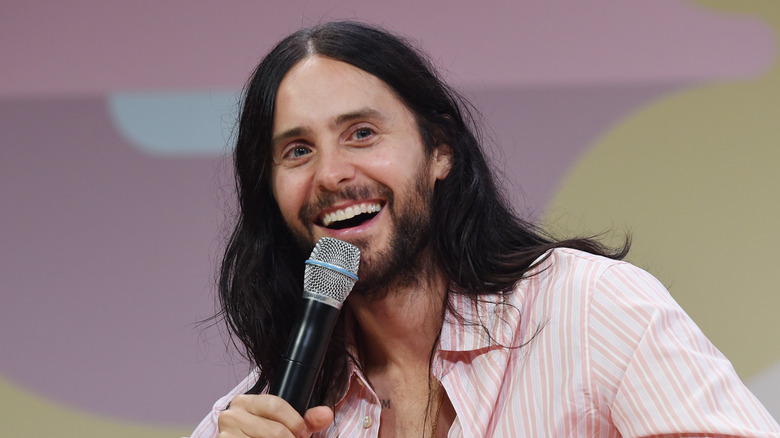 Jared Leto sitting on couch