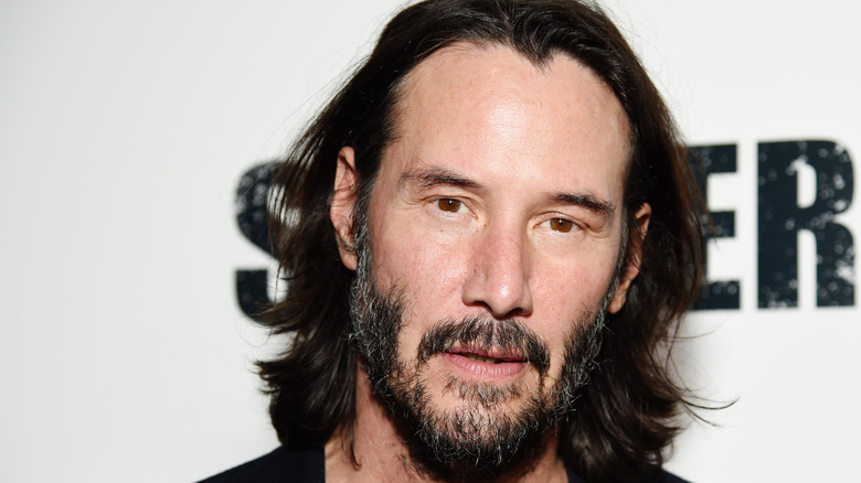 Keanu Reeves with long hair and beard
