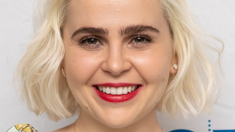 Mae Whitman poses at event