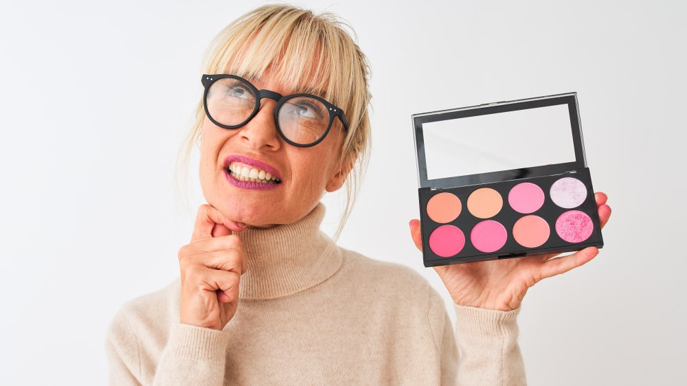 Older woman with makeup palette