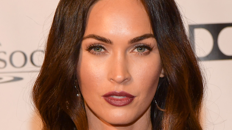 Megan Fox posing at red carpet event