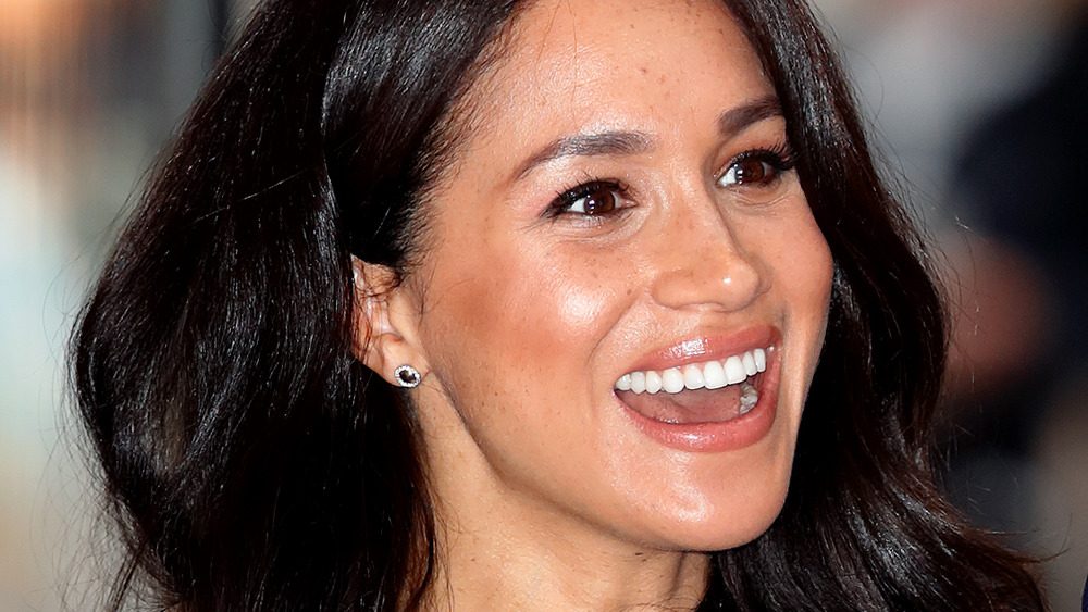 Meghan Markle looking happy as she attends a charity event in October 2019