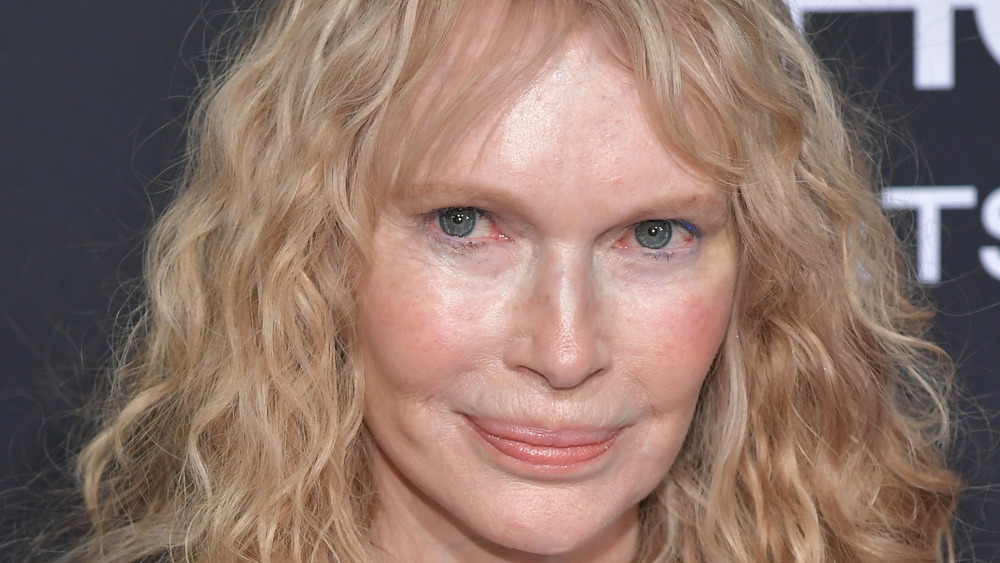 Mia Farrow grinning with hair down