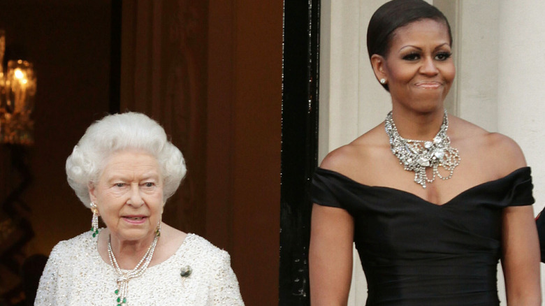 Barack and Michelle Obama and Queen Elizabeth posing together
