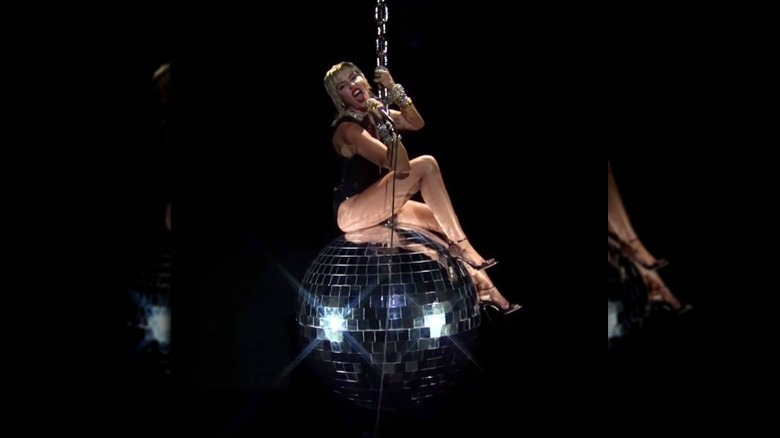 Miley Cyrus swings on giant disco ball in 2020 MTV VMA performance