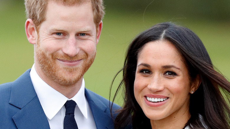 Meghan and Harry taking engagement photos