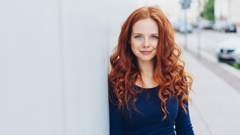 A redheaded woman outside
