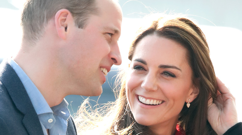 Kate Middleton and Prince William waving