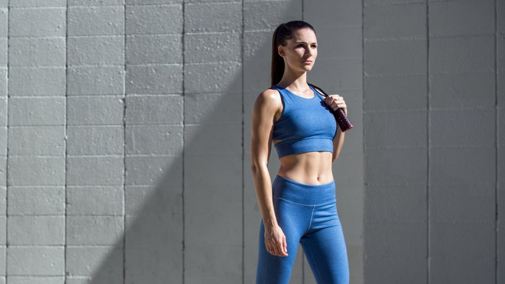 woman with toned abs walking