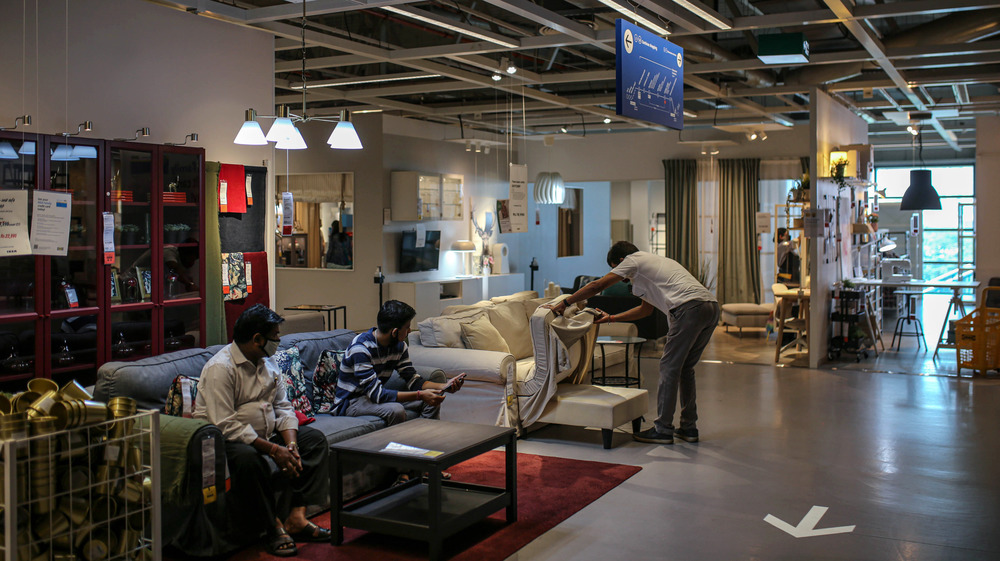 IKEA customers inspecting furniture