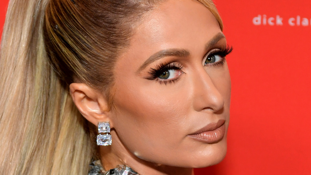 Paris Hilton looking serious with hair pulled back