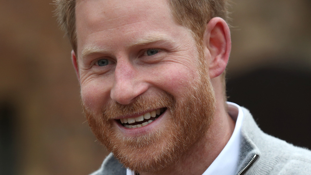 Prince Harry laughs outside