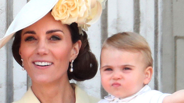 Prince Louis shows off in his mother's arms
