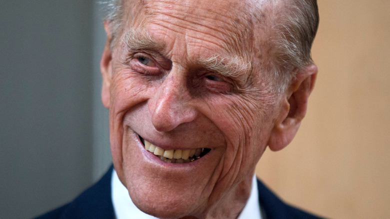 Prince Philip smiling head tilted