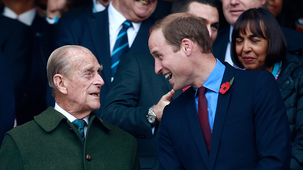 Prince Philip and Prince William at event