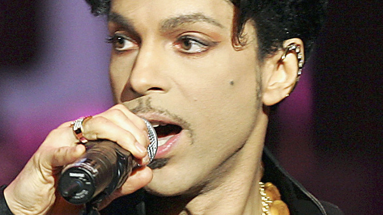 Musician Prince singing on stage
