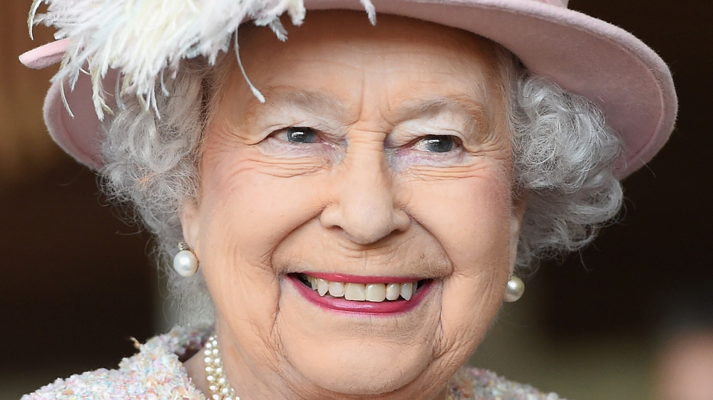 Queen Elizabeth smiles at an event