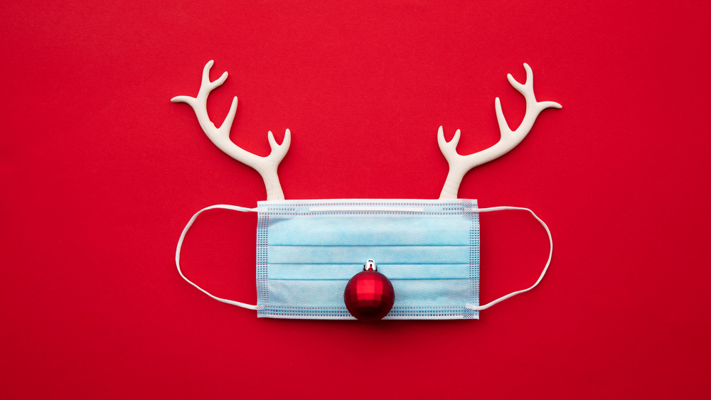 Rudolph reindeer mask red background christmas