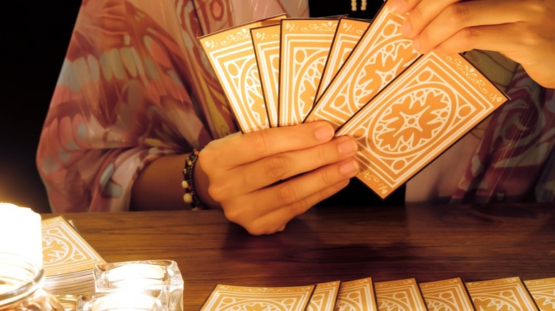 A tarot reader is preparing for a reading
