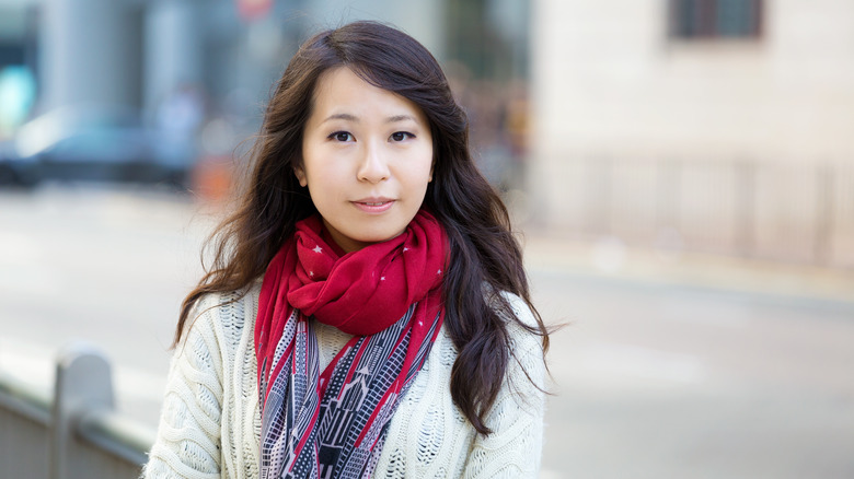 A woman wearing a red scarf