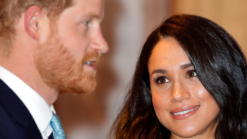 Meghan Markle looking lovingly at Prince Harry