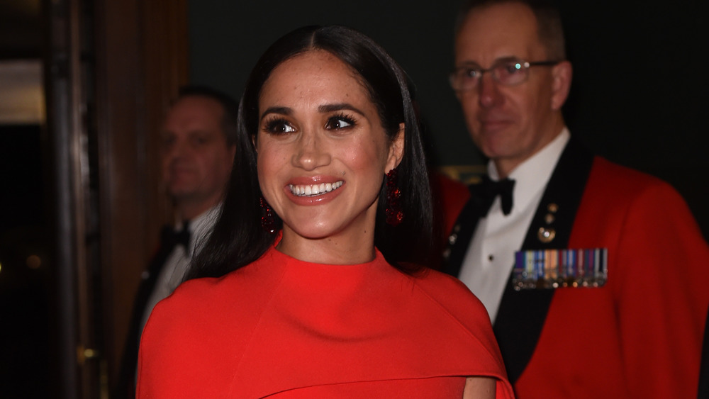 Meghan Markle in a red gown