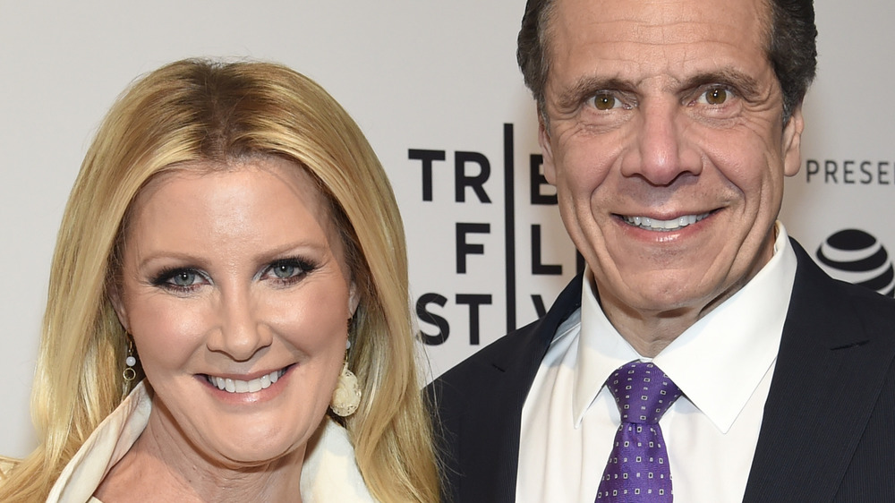 Andrew Cuomo and Sandra Lee smile