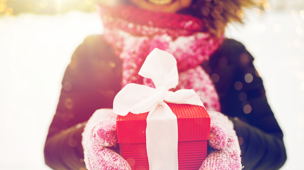 Woman holding the perfect gift