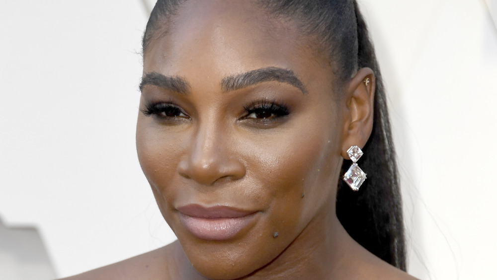 Serena Williams grinning with diamond earrings