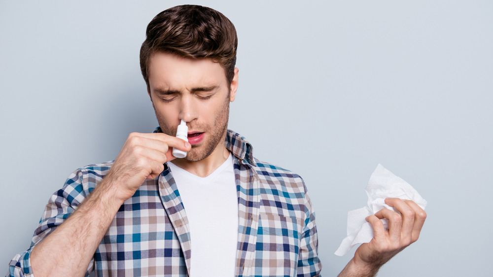 Man using nasal spray