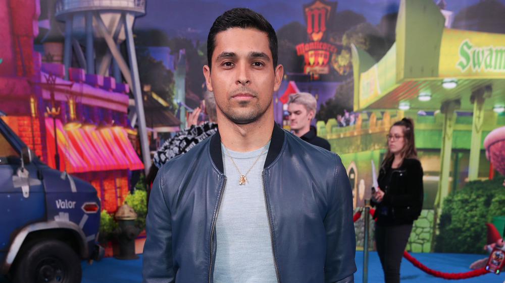 Wilmer Valderama posing in leather jacket