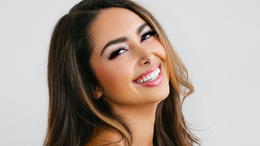 Young woman looking happy
