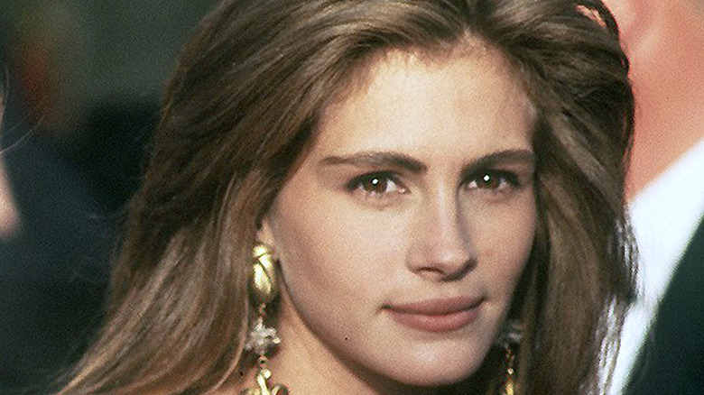 A young Julia Roberts grinning