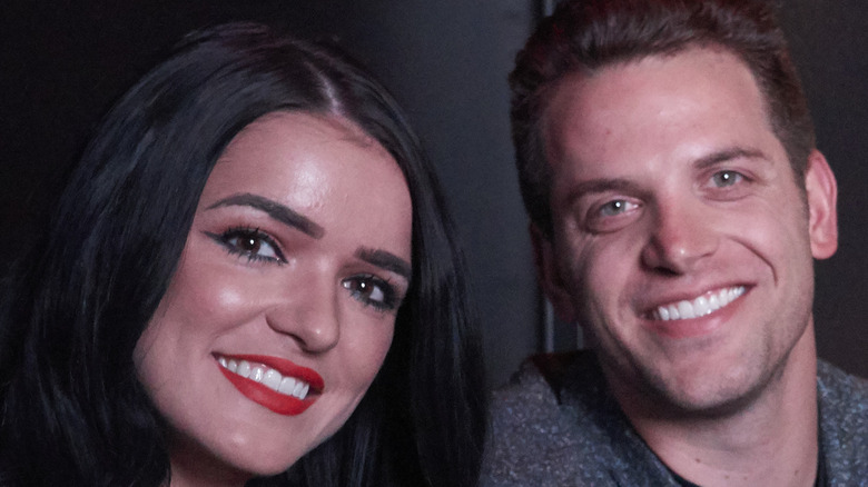 Raven and Adam smile together