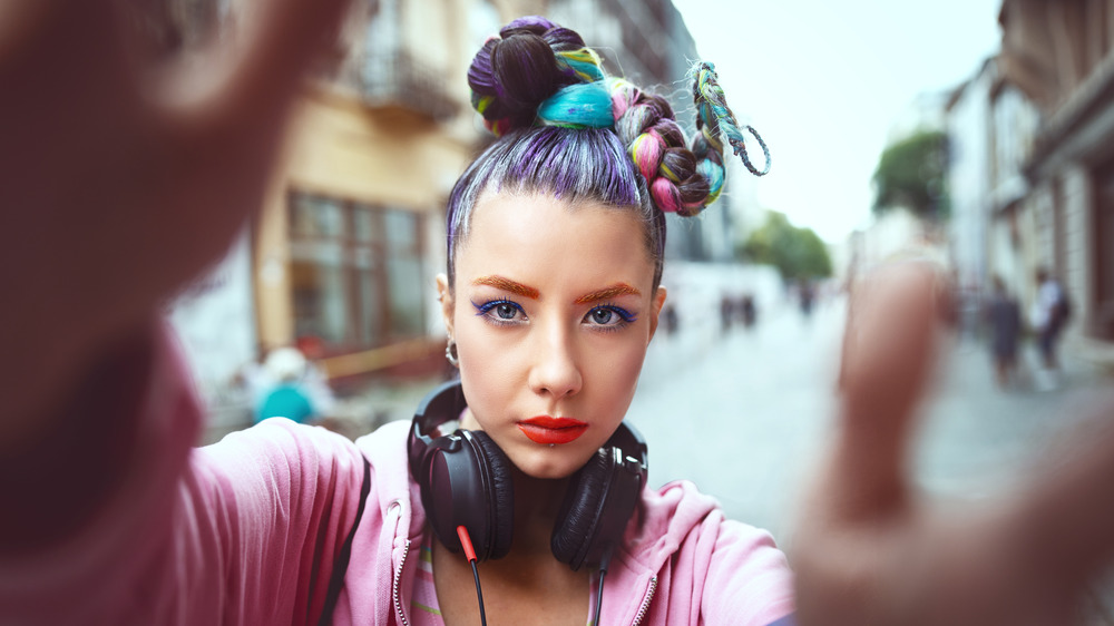 A woman with colorful hair